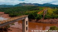 Aerial view of rail bridge taken down by a mudslide after the collapse, two days ago, of a dam at an iron-ore mine belonging to Brazil's giant mining company Vale near the town of Brumadinho, state of Minas Gerias, southeastern Brazil, on January 27, 2019. - Communities were devastated by a dam collapse that killed at least 37 people at a Brazilian mining complex -- with hopes fading for 250 still missing. A barrier at the site burst on Friday, spewing millions of tons of treacherous sludge and engulfing buildings, vehicles and roads. (Photo by Mauro PIMENTEL / AFP) (Photo credit should read MAURO PIMENTEL/AFP/Getty Images)