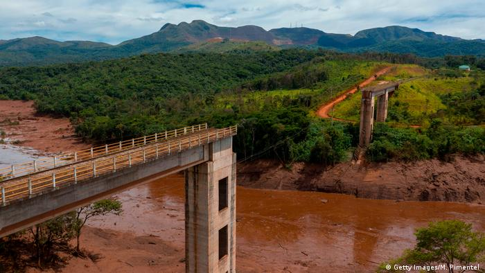 In this January 2019 file photo, an aerial view shows a rail bridge taken down by a mudslide after the collapse of a dam in Brumadinho