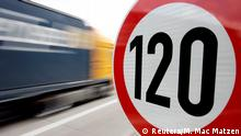 A truck passes a 120 km/h (75 mph) speed limit sign (Reuters/M. Mac Matzen)