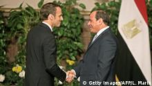 28.01.2019 *** Egyptian President Abdel Fattah al-Sisi (R) shakes hands with his French counterpart Emmanuel Macron after their joint press conference in Cairo on January 28, 2019. - Macron called for respect for individual freedoms during his meeting with Sisi on his first official visit to Egypt. (Photo by Ludovic MARIN / AFP) (Photo credit should read LUDOVIC MARIN/AFP/Getty Images)