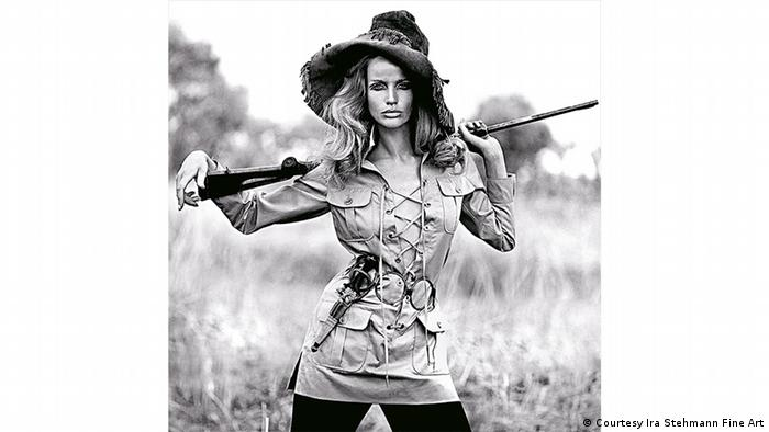 Veruschka von Lehndorff in a safari dress by Yves Saint Laurent, holding a rifle. Photo by Franco Rubartelli (Courtesy Ira Stehmann Fine Art)