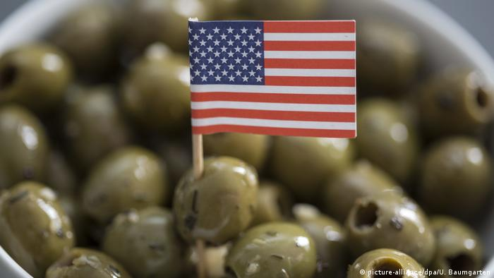 Spanish olives with a US flag stuck in one of the olives