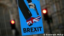 A sign is seen during an anti-Brexit demonstration outside the Houses of Parliament in London, Britain January 28, 2019. REUTERS/Hannah McKay