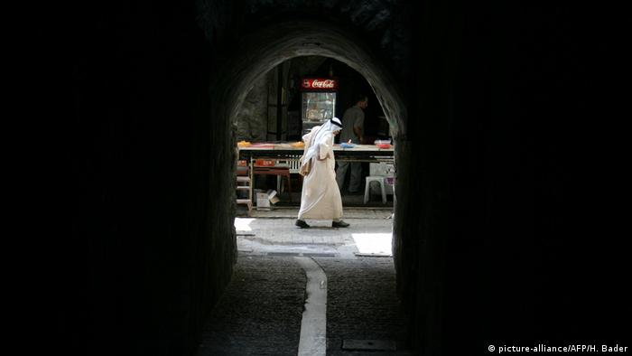 A Palestinian man walks in the old city of Hebron