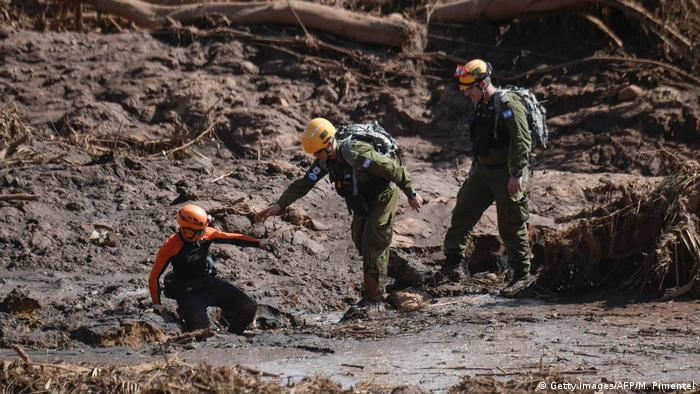 Rescuers arrive to help firefighters search for victims after a dam collapse in Brumadinho, Brazil