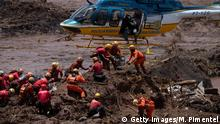 Rescuers and helicopter arrive at Brumadinho to assist in dam collapse disaster