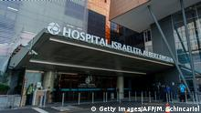 Picture of the entrance of the Albert Einstein Hospital where Brazilian President Jair Bolsonaro will undergo surgery to have a colostomy bag removed, in Sao Paulo, Brazil, taken on January 27, 2019. - Bolsonaro, who was stabbed in the stomach while campaigning in Minas Gerais state last September 6, is in Sao Paulo to undergo a surgery to remove a colostomy bag. (Photo by Miguel SCHINCARIOL / AFP) (Photo credit should read MIGUEL SCHINCARIOL/AFP/Getty Images)