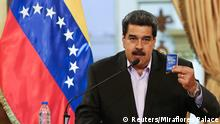 29.01.2019 Venezuela's President Nicolas Maduro holds a copy of the Venezuelan constitution while he speaks during a meeting with members of the Venezuelan diplomatic corp after their arrival from the United States, at the Miraflores Palace in Caracas, Venezuela January 28, 2019. Miraflores Palace/Handout via REUTERS ATTENTION EDITORS - THIS PICTURE WAS PROVIDED BY A THIRD PARTY.