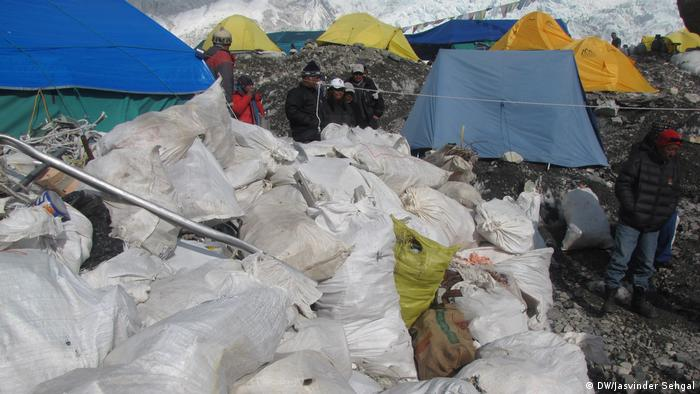 Bags of garbage pile up at Everest base camp, just next to pitched tents. Mount Everest has turned into the highest trash dump in the Himalayan mountains.