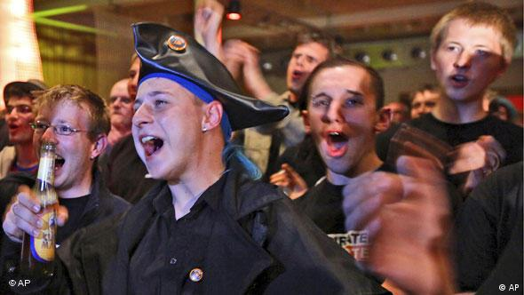 Supporters of the Pirate party celebrate during election day in Berlin