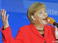 La canciller alemana Angela Merkel sonríe el conocer el resultado de las elecciones en 2009.