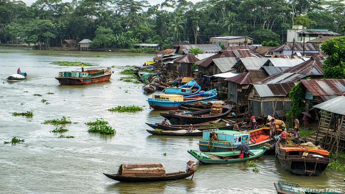 Boats pull up to shanties in Bangladesh