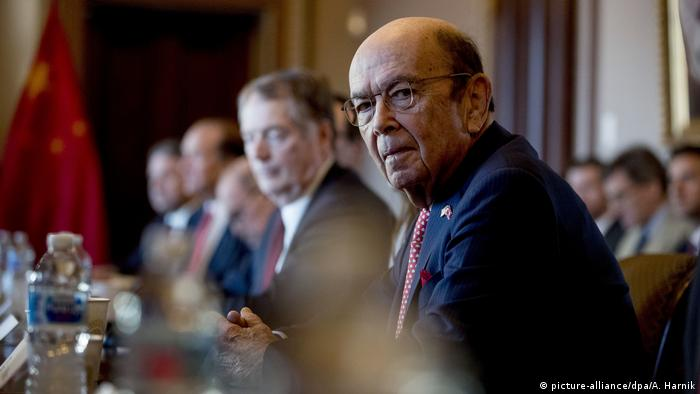 Wilbur Ross seated at a desk