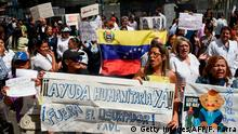 Demonstrators demand humanitarian aid during a protest against the government of President Nicolas Maduro, called by opposition leader and self-proclaimed acting president Juan Guaido, outside the Dr. JM de los Rios Children's Hospital in Caracas on January 30, 2019. - Venezuelan President Nicolas Maduro hit out Wednesday at military mercenaries he says are conspiring to divide the armed forces and plot a coup as the opposition planned a new protest to force the socialist leader from power. (Photo by Federico Parra / AFP) (Photo credit should read FEDERICO PARRA/AFP/Getty Images)