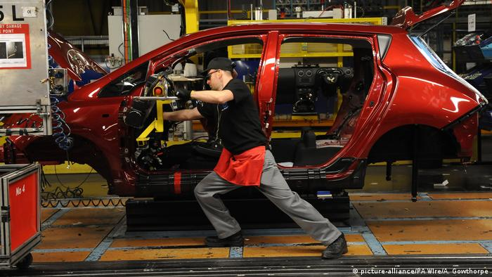 A worker at a car production plant in the UK