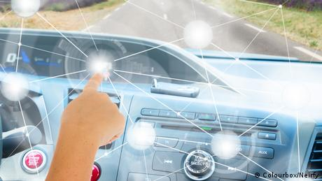 A generic picture showing a driver programming the features of a future car via touchscreen