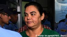 Honduran former first lady, Rosa Elena Bonilla de Lobo, wife of Honduran former president (2010-2014) Porfirio Lobo Sosa, is escorted as she arrives at a corruption court in Tegucigalpa on February 28, 2018. Bonilla de Lobo was arrested on Wednesday on charges of embezzling millions of dollars of public funds, authorities said. / AFP PHOTO / ORLANDO SIERRA (Photo credit should read ORLANDO SIERRA/AFP/Getty Images)