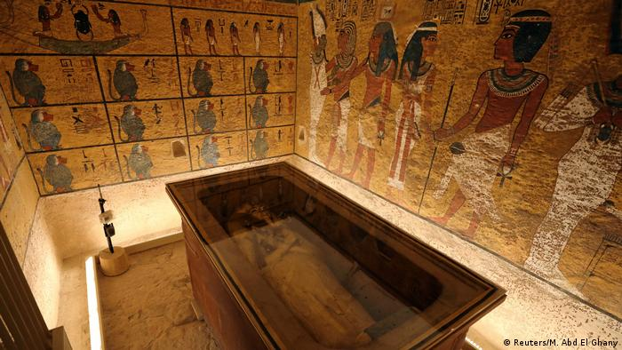 The sarcophagus of Tutankhamun on display under glass in the tomb