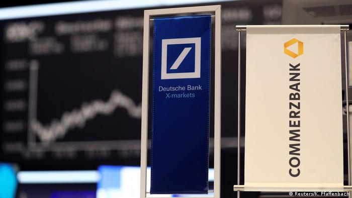 Banners for Deutsche Bank and Commerzbank (Reuters/K. Pfaffenbach)