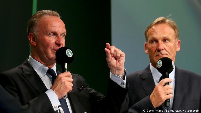 Bayern Munich CEO Karl-Heinz Rummenigge and Borussia Dortmund CEO Hans-Jaochim Watzke