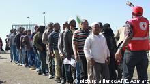 Ethiopians stand in line as they arrive at Bole International Airport in Ethiopia¿s capital, Addis Ababa, Wednesday, Dec. 18, 2013, after they were deported from Saudi Arabia. An Ethiopian government official said Tuesday that at least 136,000 Ethiopians have been sent home from Saudi Arabia as part of its crackdown on migrant workers that began Nov. 4 targeting the kingdom's 9 million migrant labourers. (AP Photo/Elias Asmare) |