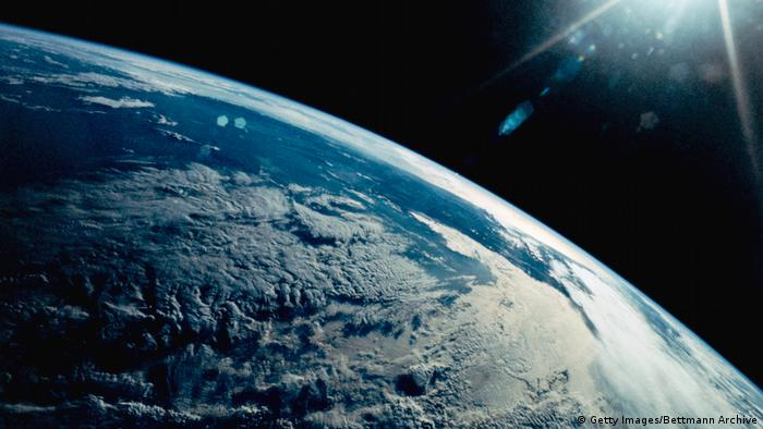 A view of Earth from the Space Shuttle Discovery shows late afternoon sun on the Andes Mountains