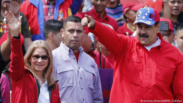 Nicolas Maduro and his wife wave to supporters at a rally
