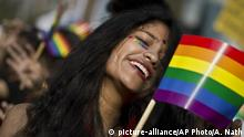 A participant waves a rainbow flag as supporters of the lesbian, gay, bisexual and transgender community participate in a gay pride parade in Gauhati, India, Sunday, Feb. 3, 2019. Homosexuality has gained a degree of acceptance in deeply conservative India over the past decade, particularly in big cities. (AP Photo/Anupam Nath) |