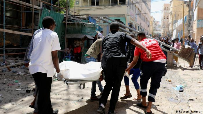 People carrying a stretcher in Mogadishu, Somalia (Reuters/F. Omar)