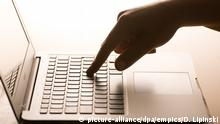 """Social media report. File photo dated 04/03/17 of a woman's hand pressing a key of a laptop keyboard. MPs have accused social media giants of a """"shameful"""" failure to tackle online terrorist propaganda and hate speech. Issue date: Monday May 1, 2017. A hard-hitting report accused major firms of putting more effort into protecting their profits than keeping the public safe online. See PA story POLITICS Hate. Photo credit should read: Dominic Lipinski/PA Wire URN:31136141 