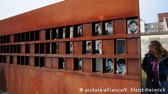 A metal display shows the photos of the victims of the Berlin Wall