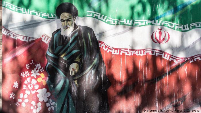 Street art showing the Iranian flag and Ruhollah Khomeini