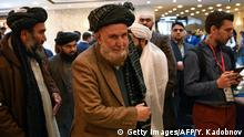 Delegates arrive to attend a two-day gathering of the Taliban and Afghan opposition representatives at the President Hotel in Moscow on February 5, 2019. (Photo by Yuri KADOBNOV / AFP) (Photo credit should read YURI KADOBNOV/AFP/Getty Images)