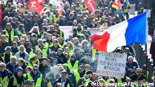 05.02.2019 *** Yellow vest protestors (gilets jaunes) and union members march during a 'day of strike' called by France's CGT union in the southern French city of Marseille, on February 5, 2019. - The sign reads the richer they become they more numerous we will be. (Photo by GERARD JULIEN / AFP) (Photo credit should read GERARD JULIEN/AFP/Getty Images)