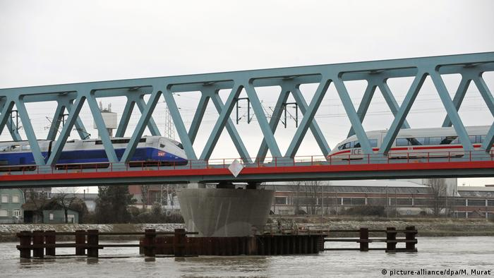 France's TGV train and Germany's ICE train travelling on a bridge in Kehl