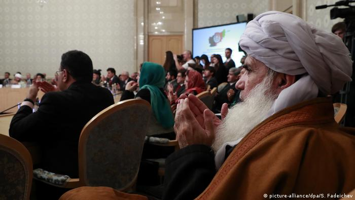 Taliban members, politicians and women discuss the future of Afghanistan at a round table