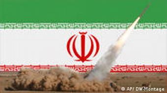 A Fateh missile is launched in front of an Iranian flag.