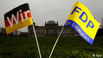 The Christian Democrats and Free Democrats party flags in front of parliament in Berlin.