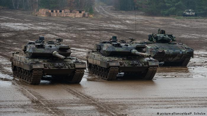 Two Bundeswehr Leopard 2A6 tanks and one Puma armoured infantry vehicle during a training excersise