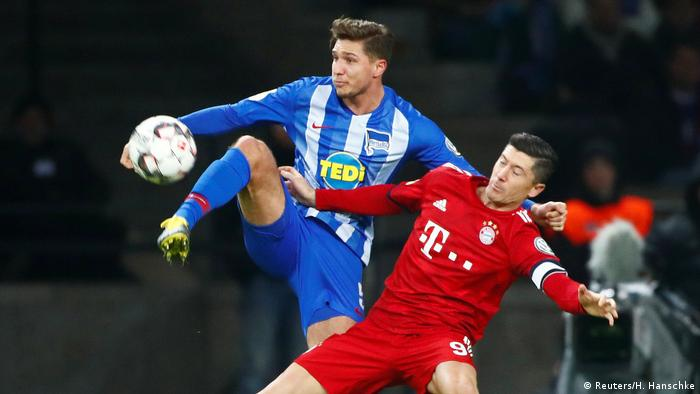 Niklas Stark and Robert Lewandowski (Reuters/H. Hanschke)
