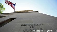 WASHINGTON, DC - MAY 24: An American flag flies outside of the Justice Department, on May 24, 2018 in Washington, DC. Today lawmakers are attending classified meeting in regards to the FBI's confidential intelligence source in the Russia investigation. (Photo by Mark Wilson/Getty Images)