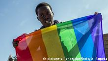 Participants of the Swakopmund Gay Pride walks on the main street of the city, June 4, 2016, Namibia. People from all over the country met for the first time for pride march in Namibia for supporting LGBT community. 'ÄúWe are one of the most development and peaceful countries in Africa but we still haven'Äôt a well-organized LGBT community, so today is an important day for uniting people. Hopefully, next year we will be able to organize a weeklong festival to celebrate love in Swakopmund all together'Äù, said Florance Khoxas, LGBT rights activist and an organizer of Swakopmund Pride. (Photo by Oleksandr Rupeta/NurPhoto)   Keine Weitergabe an Wiederverkäufer.