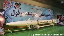 """In this photo released Thursday, Feb. 7, 2019, by Sepahnews, the website of the Iranian Revolutionary Guard, a Dezful surface-to-surface ballistic missile is displayed in an undisclosed location in Iran. Banner in Persian reads: the inauguration ceremony of Dezful missile, and above that is a line from the Quran. A Thursday report by the semi-official Fars news agency, close to the Guard, said a ceremony marking the inauguration of the ballistic missile was held in an underground missile factory described as an """"underground city."""" (Sepahnews via AP) 