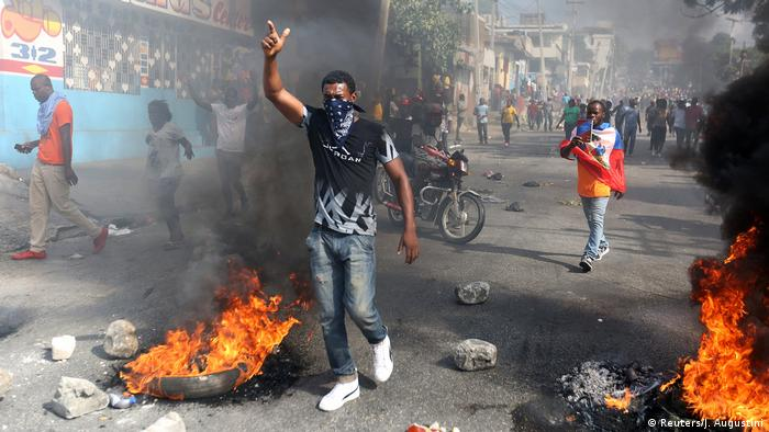 Demonstrators in Port-au-Prince take part in a protest against former government officials accused of misusing Petrocaribe funds and the country's inflation rate