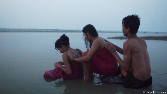 Film still Bulbul Can Sing, three young people in a lake (Flying River Films)