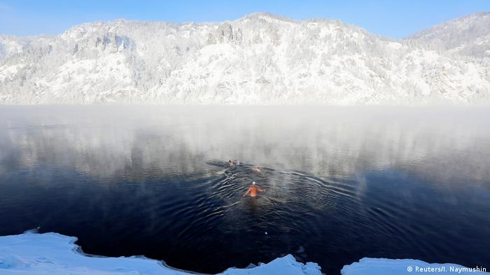 Members of a winter swimming club swim in the icy waters of the Yenisei River in Divnogorsk (Reuters/I. Naymushin)