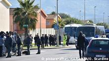 07.02.2019 Police officers stand in the refugees center of Mineo as busses arrive to transfer the first migrants to the Special Assistance Center of Trapani, in Mineo, near Catania, Italy, Thursday, Feb. 7, 2019. The Council of Europe's human rights commissioner Dunja Mijatovic said Thursday she is deeply concerned about Italy's treatment of migrants at home and at sea and is seeking clarification from the government about a recent law and move to empty big migrant welcome centers. (Orietta Scardino/ANSA via AP) |