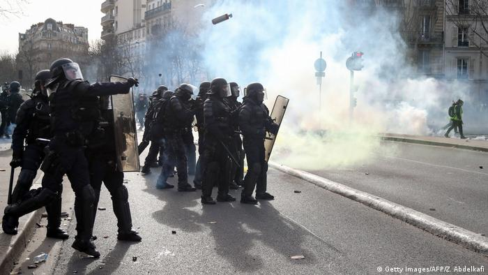 Smoke on a street with riot police in the foreground (Getty Images/AFP/Z. Abdelkafi)