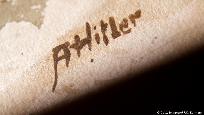 A 2018 close-up picture of the signature A Hitler on a watercolor entitled Im Wald