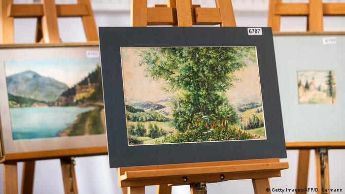 A picture taken in 2019 shows a watercolor entitled Buschgruppe (bush group) signed A. Hitler on display at the Weidler auction house